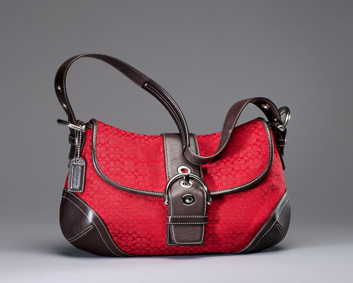Coach handbag red with dark brown leather trim by Bret Doss Commercial Product Photography Seattle