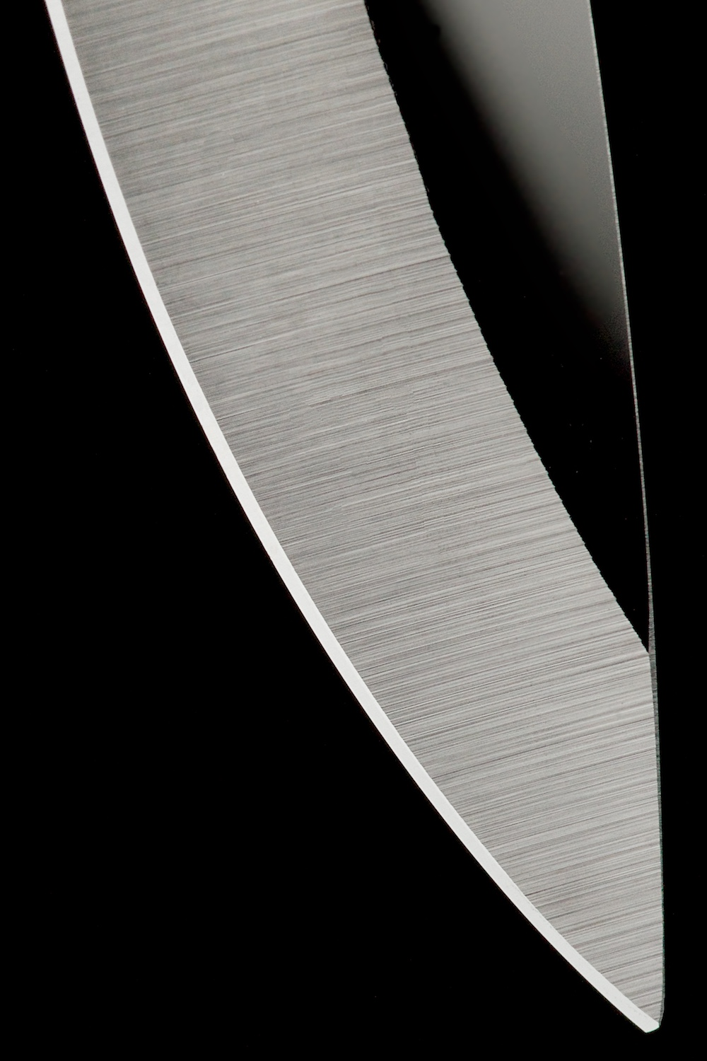 Knife blade detail abstract black & white by Bret Doss Commercial Product Photography Seattle